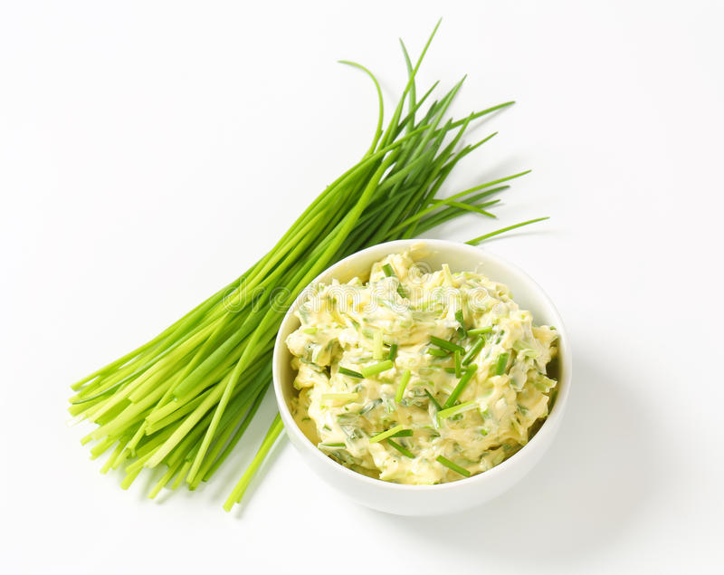 Chive butter. Bowl of homemade chive butter stock image