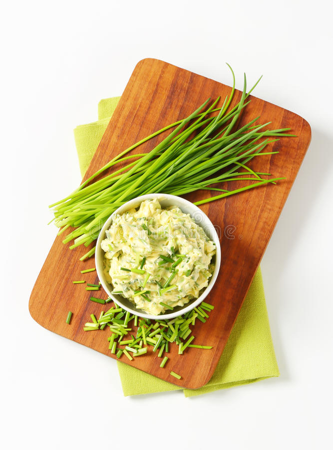 Chive butter. Bowl of homemade chive butter royalty free stock photography