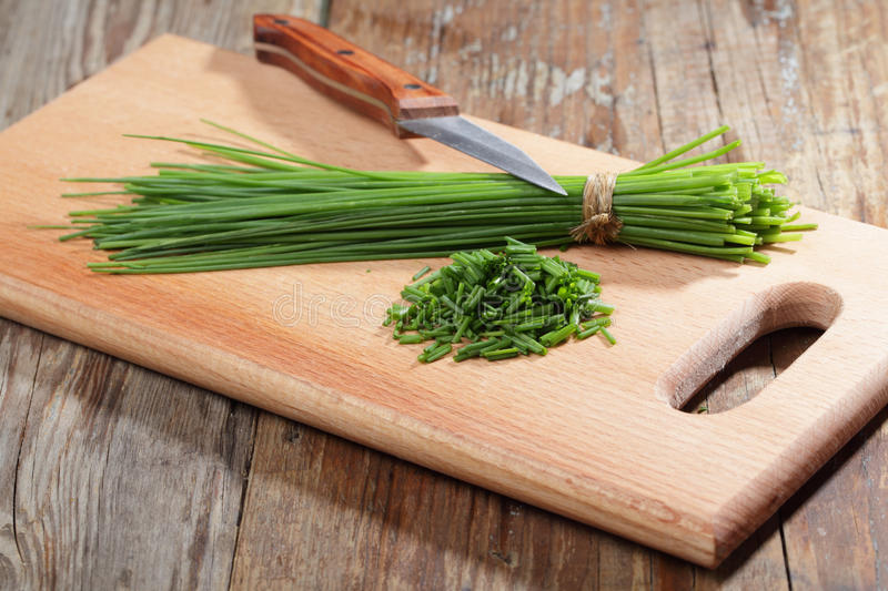 Chives on a cutting board royalty free stock photo