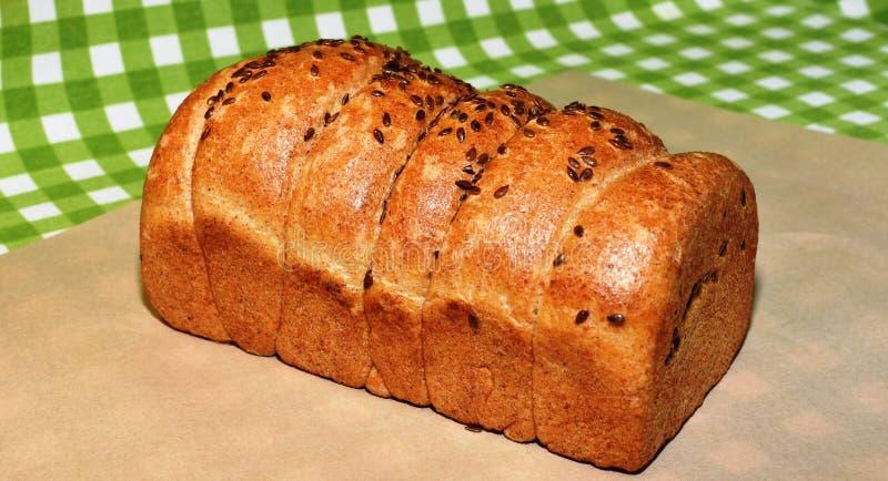 Chleb gomółka sezam i ciasto fotografia stock