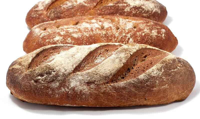 Chleb - raye sourdough chleb, kilka bochenki w pobliżu obrazy stock