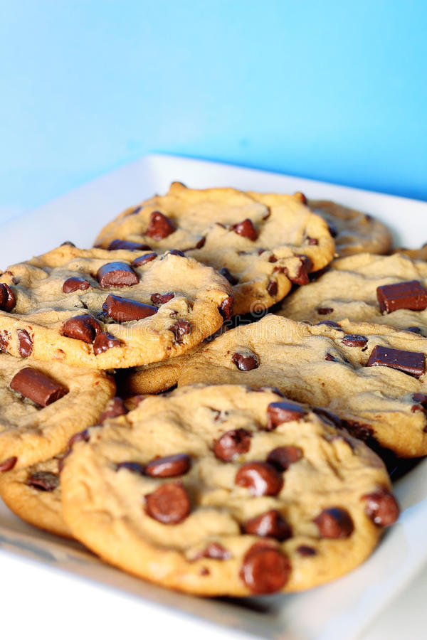 Choc chip cookie stack on blue vertical. Shot of choc chip cookie stack on blue vertical stock photos