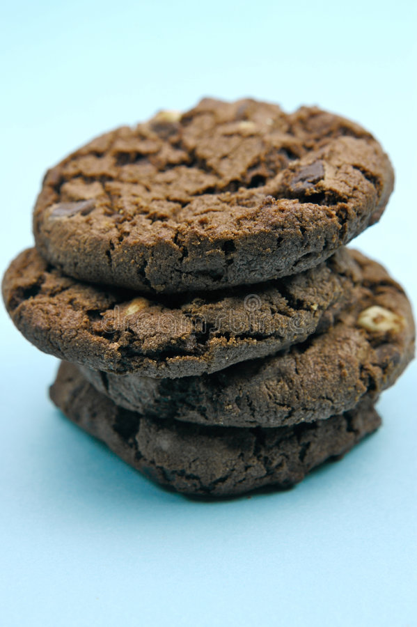 Choc Chip Cookies. Isolated against a blue background stock images