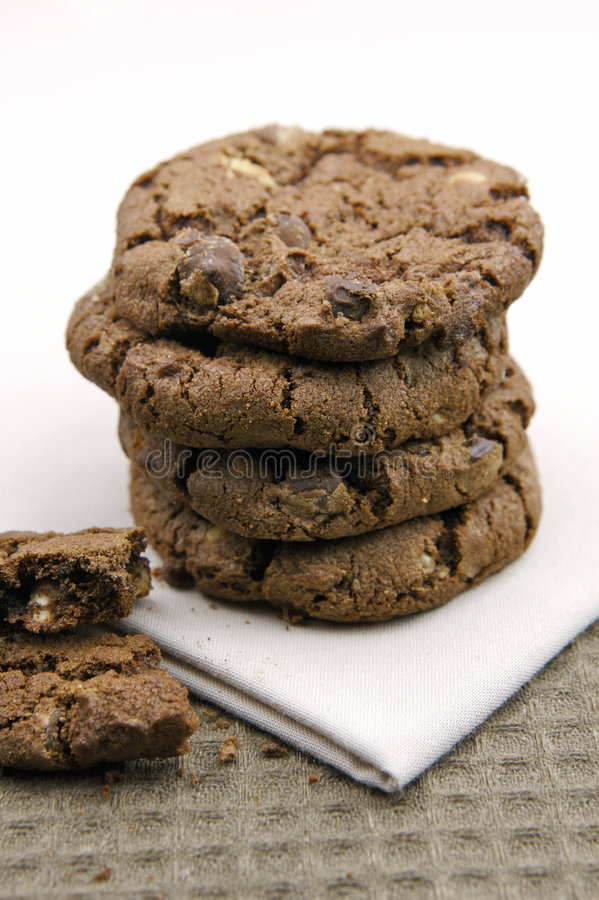 Choc Chip Cookies. Isolated against a blue background stock photo