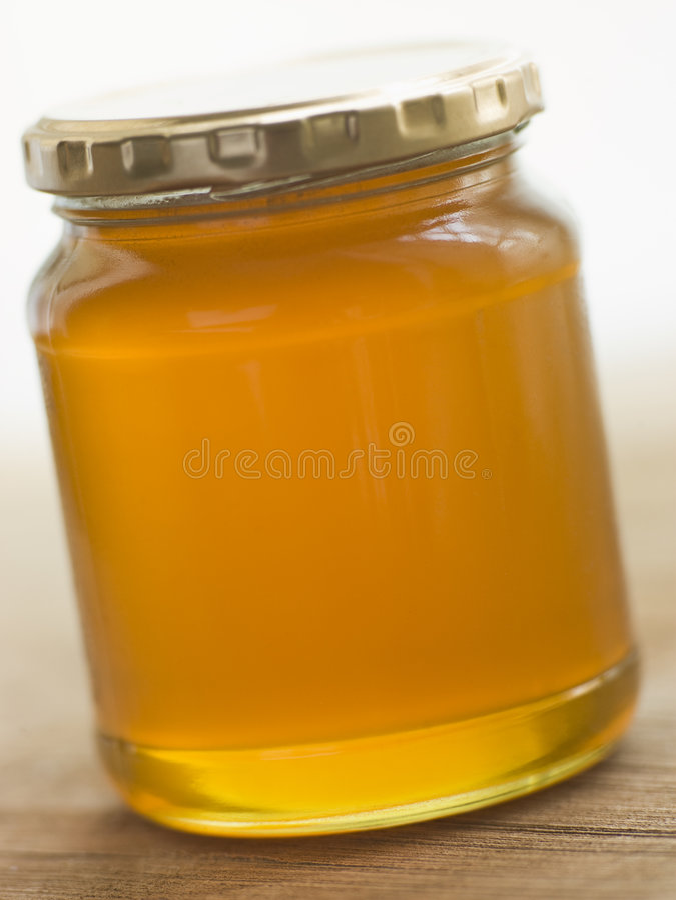 Choc de miel et de cuillère images libres de droits