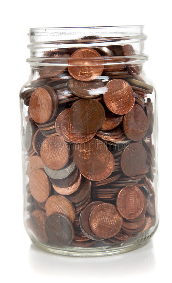 Choc en verre complètement de pièces de monnaie image libre de droits