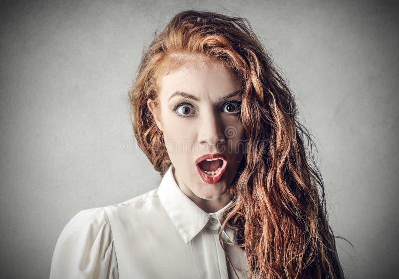 Chockad kvinna royaltyfri foto
