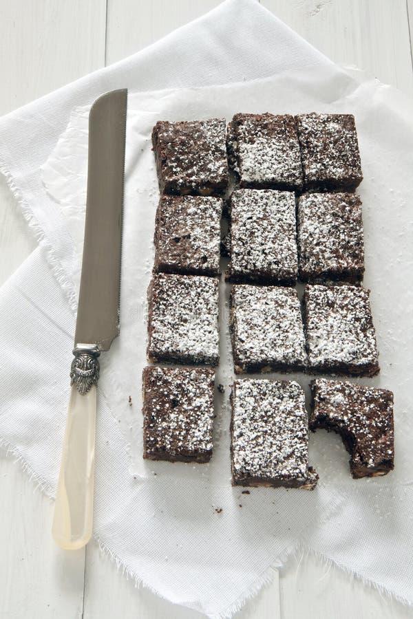 Chocolade brownies met mes stock foto's