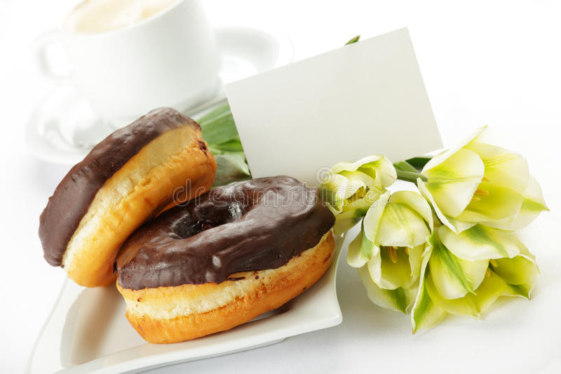 Chocolade donuts stock afbeelding