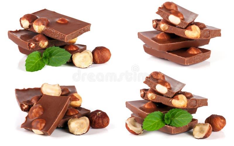 Chocolade met hazelnoot en muntblad op witte achtergrond wordt geïsoleerd die Reeks of inzameling stock foto
