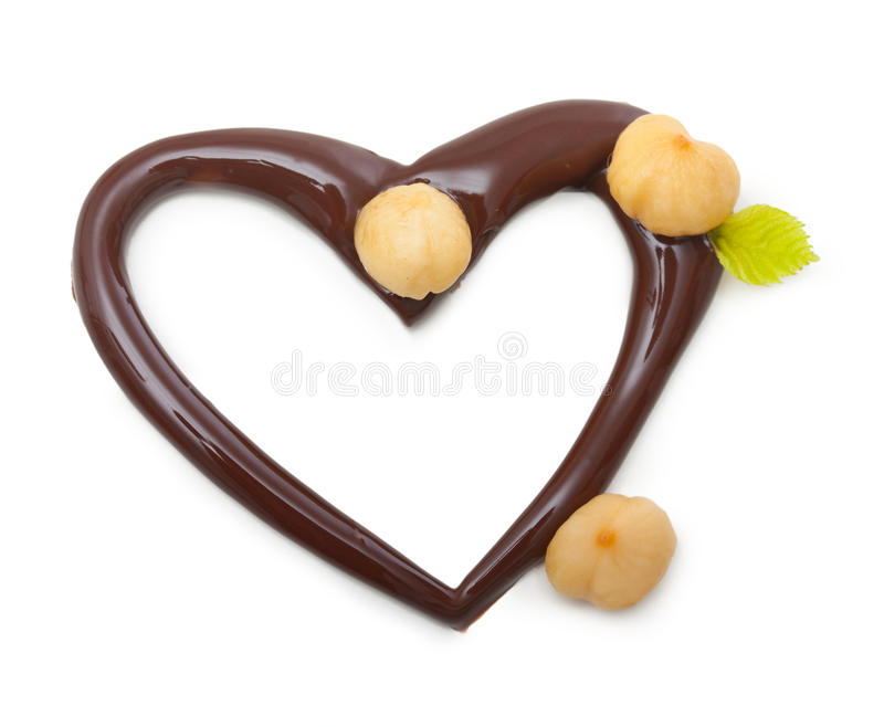 Chocoladehart met noten stock fotografie