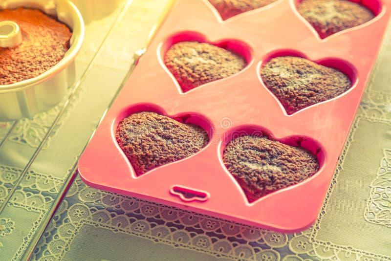 Chocolademuffins (het Gefiltreerde beeld verwerkte uitstekend EF stock afbeelding