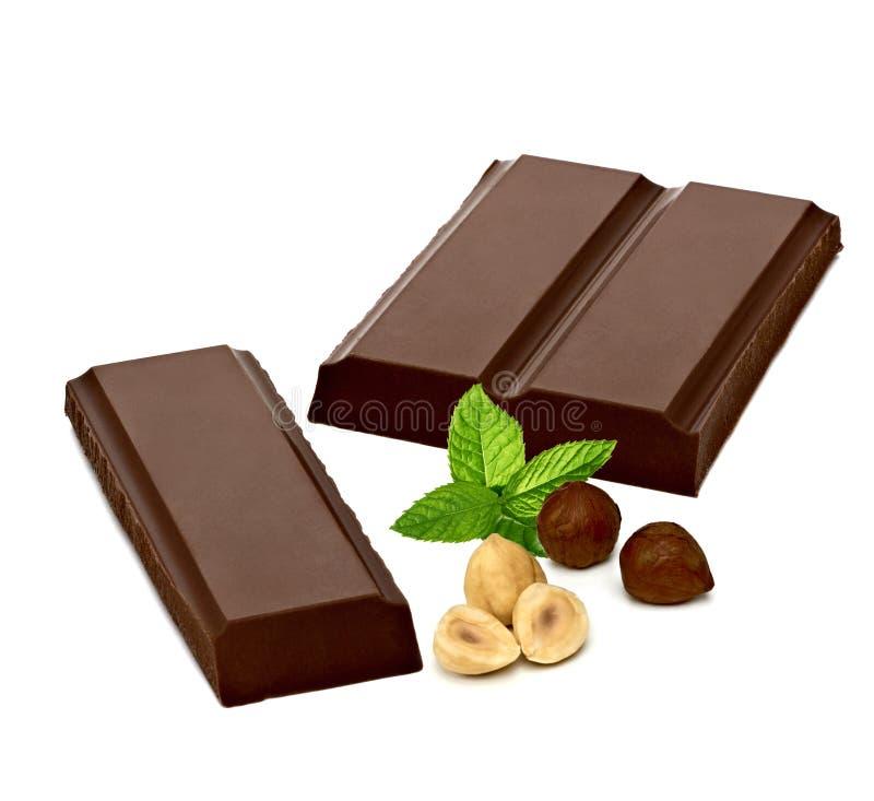 Chocoladerepen en hazelnoten of hazelnoten stock afbeelding