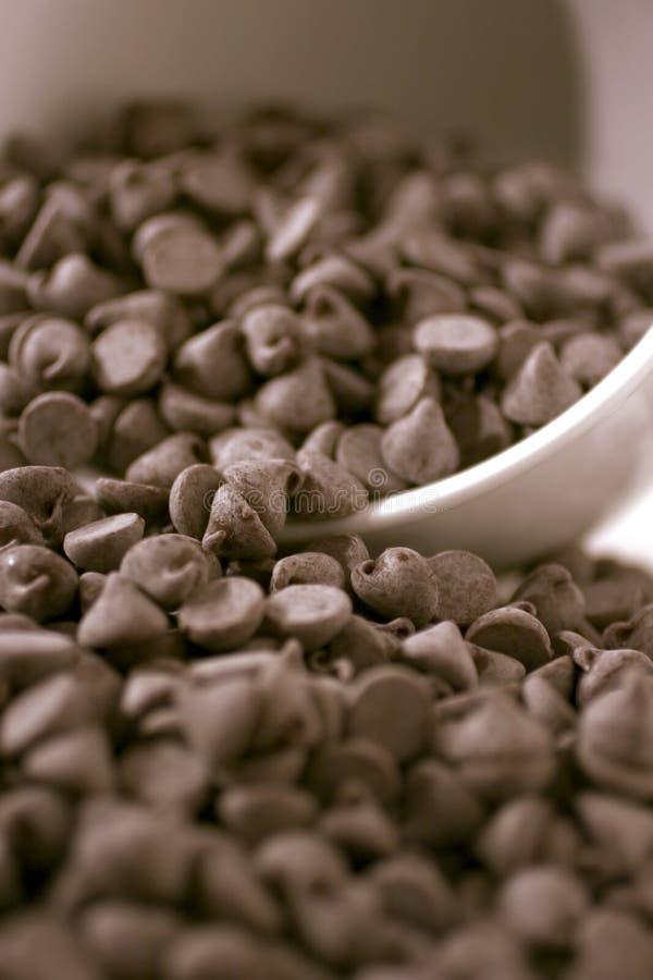 Chocoladeschilfers het overlopen stock afbeeldingen