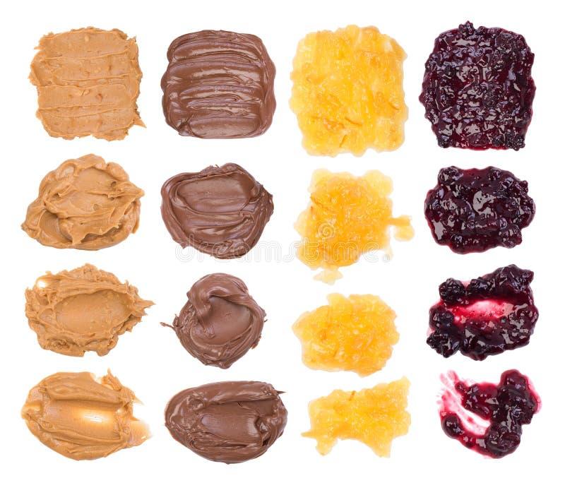 Chocolat, beurre d'arachide et gelée sur le fond blanc images libres de droits