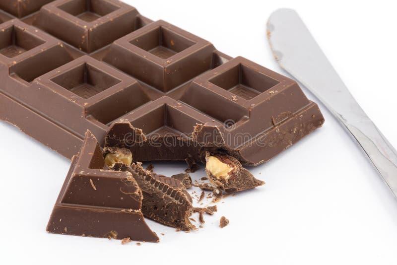 Chocolat et noisettes du lait photo stock