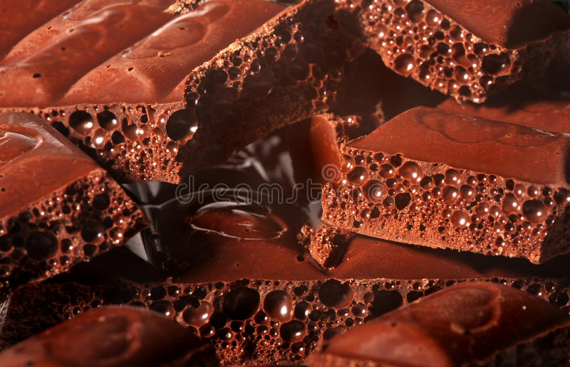 Chocolate. Pieces of chocolate whits bubbles stock image