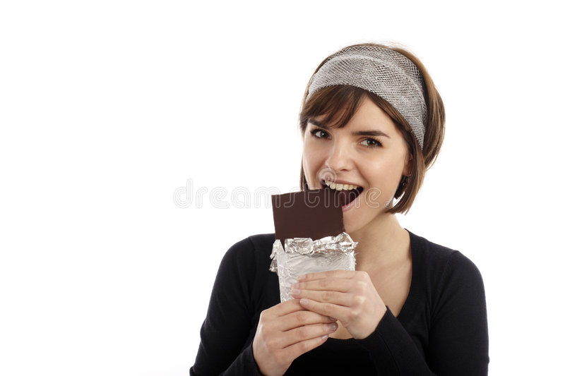 Chocolate. Stock Photography of pretty young woman eating chocolate royalty free stock photography