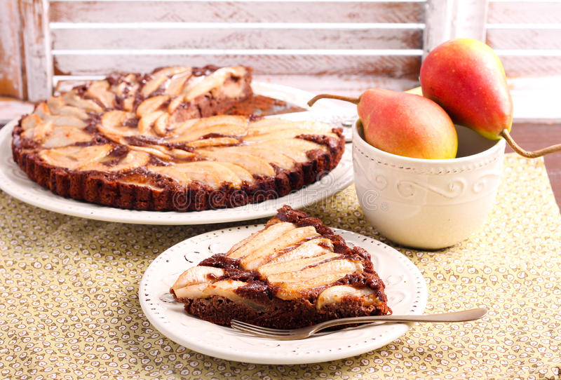 Chocolate and almond tart with pear royalty free stock photos
