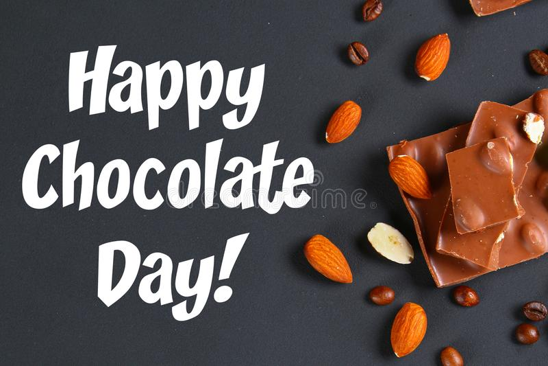 Chocolate with almonds on dark grey background. July 11 is the day of chocolate. Chocolate with almonds on dark grey background. July 11 is the day of chocolate stock image