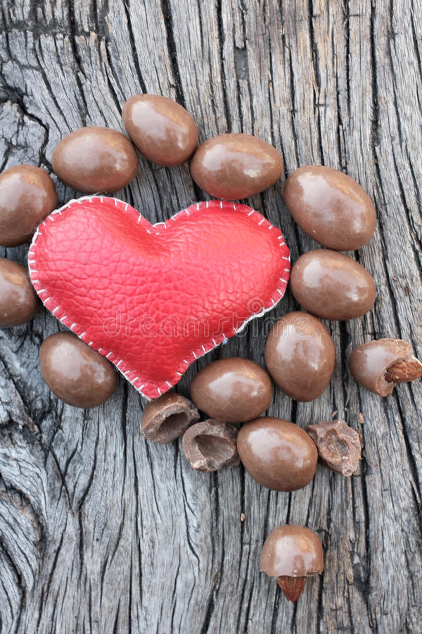 Chocolate almonds with heart royalty free stock photo