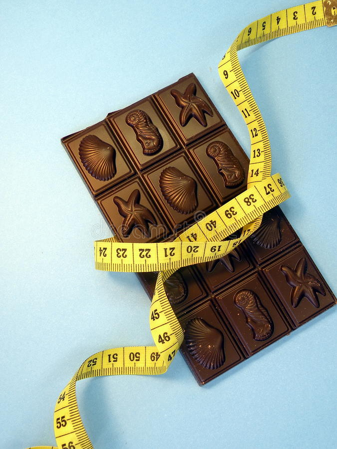 Free Chocolate And Measuring Tape Royalty Free Stock Photography - 18283867