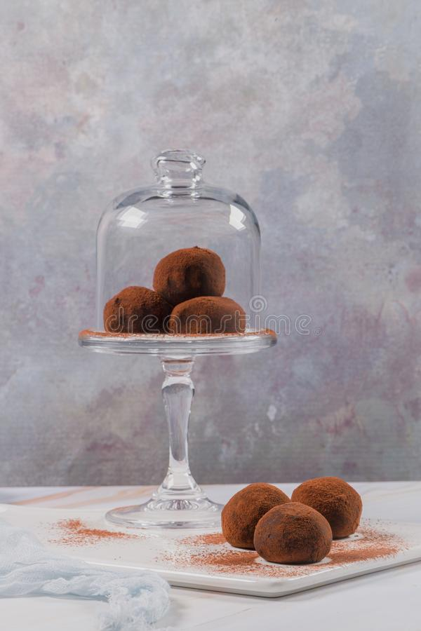 Chocolate balls cakes in a glass stand. Cocoa balls, chocolate balls cakes in a glass stand, sprinkled with cocoa powder royalty free stock photography