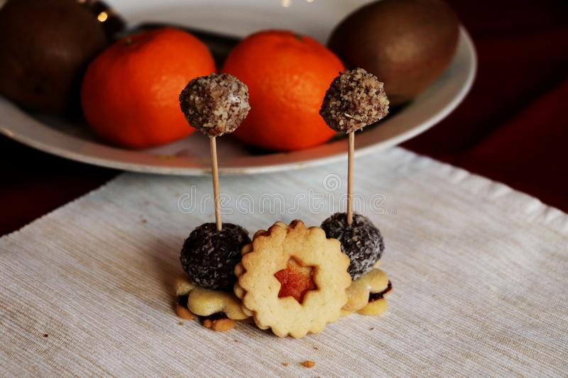 The chocolate balls spellet on a spit with sweets royalty free stock images