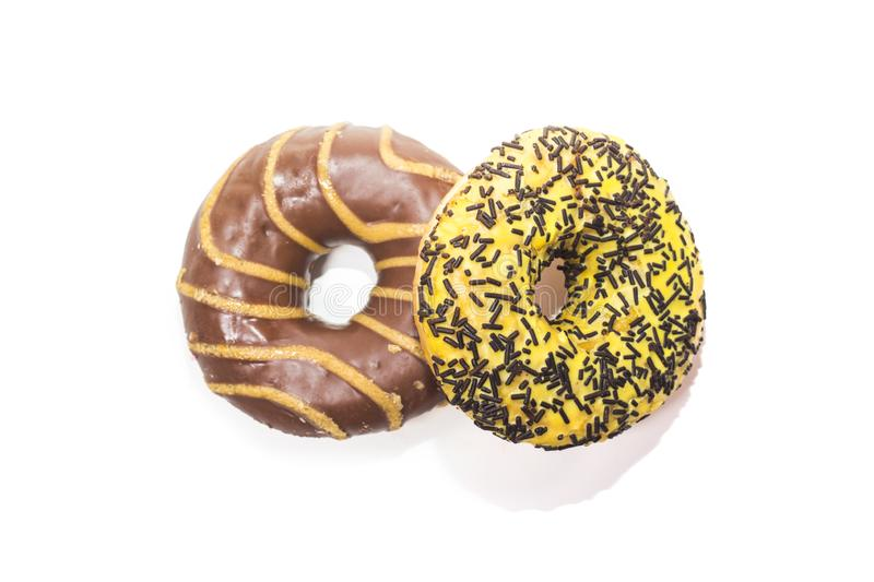 Chocolate and banana donuts on white background royalty free stock photos