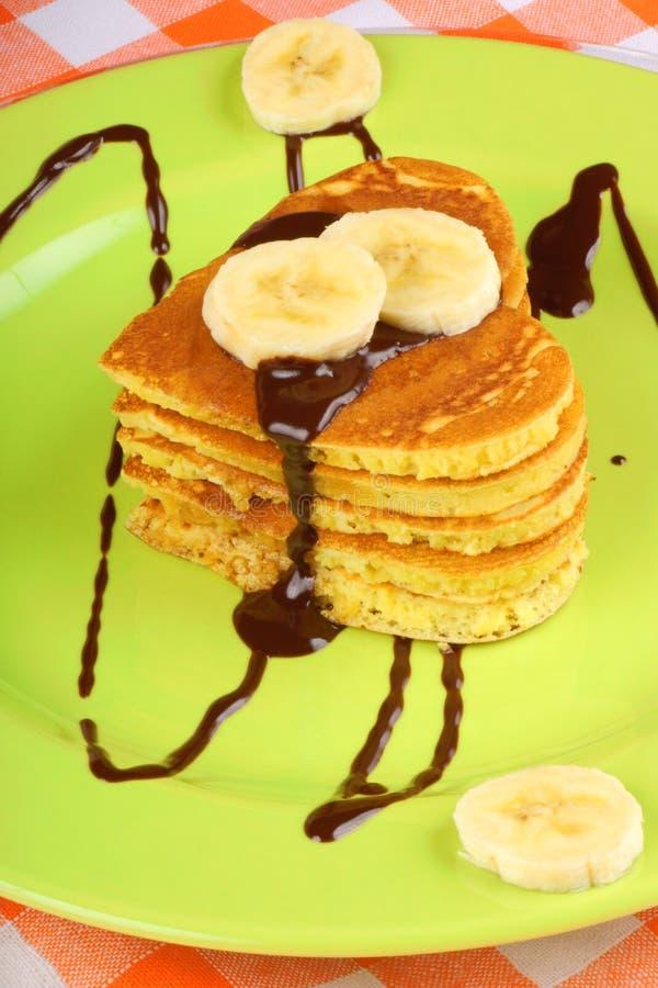 Chocolate and banana heart shaped pancakes stock image