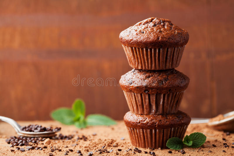 Chocolate banana muffin on brown background. Delicious homemade dessert. royalty free stock photos