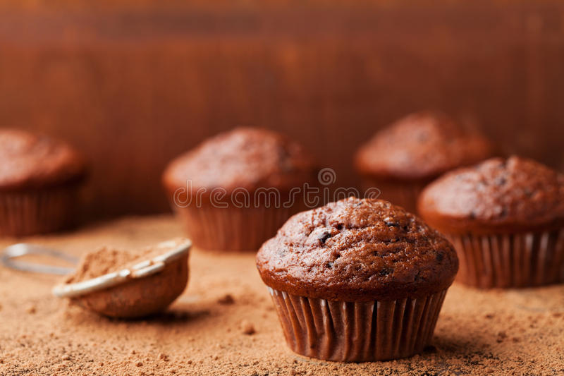 Chocolate banana muffin on brown rustic background. Delicious homemade bakery. stock image
