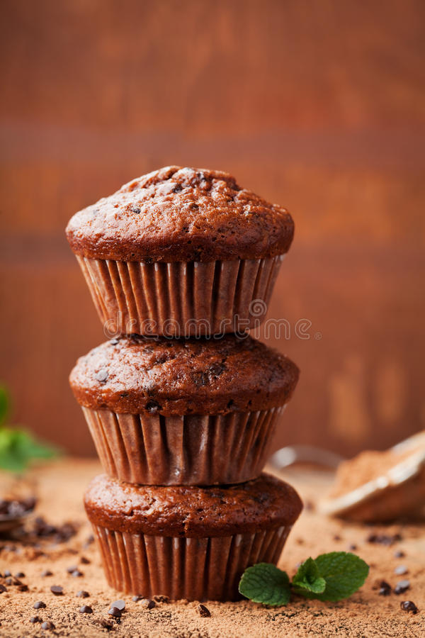 Chocolate banana muffin on wooden background. Delicious homemade bakery. stock photos