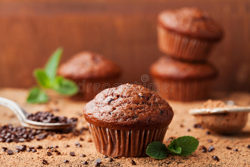 Chocolate banana muffin on wooden vintage background. Delicious homemade bakery. royalty free stock photo