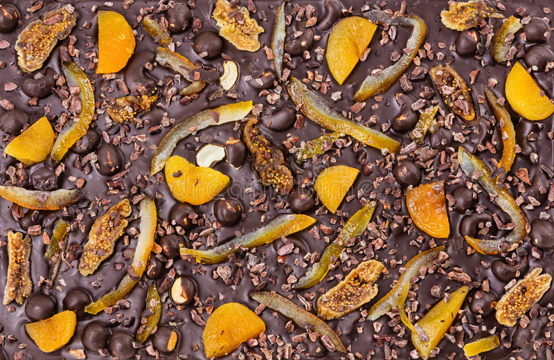 Chocolate bar with dried fruit and nuts stock images