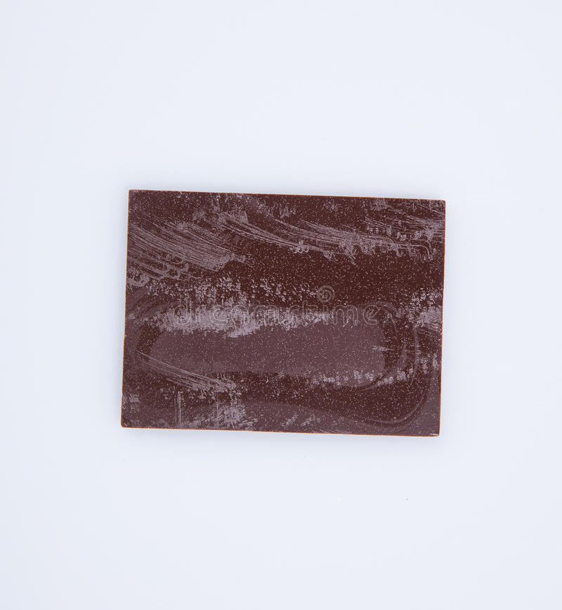 Chocolate bar or pieces on a background. royalty free stock photos
