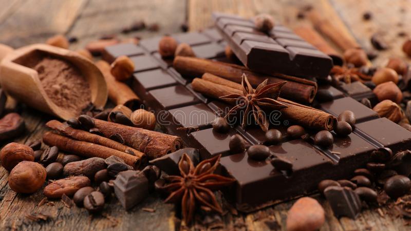 Chocolate bar and spices royalty free stock photo