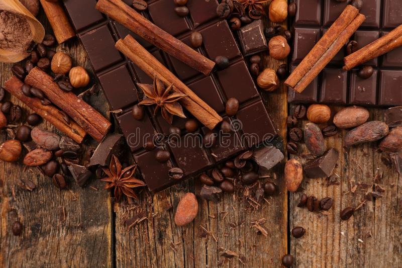 Chocolate bar and spices royalty free stock image