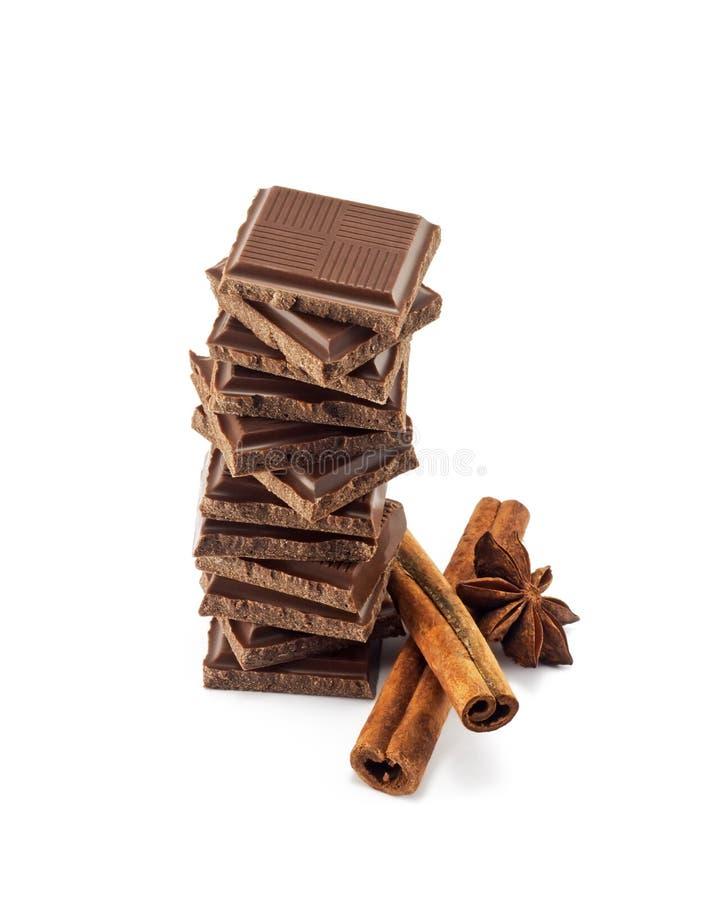 Chocolate bars stack and cinnamon sticks stock image