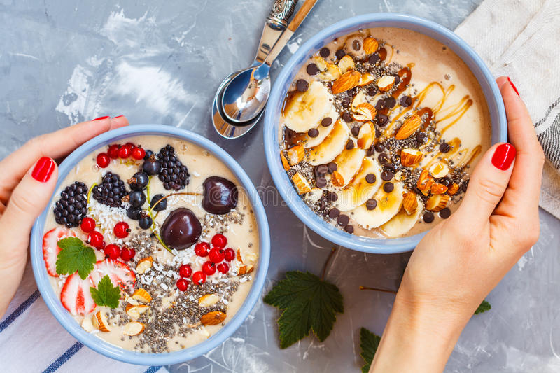 Chocolate and berry smoothies bowls. Healthy vegan breakfast: chocolate and berry smoothies bowls stock photography