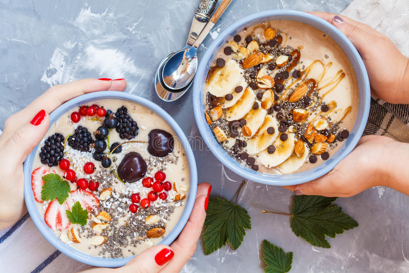 Chocolate and berry smoothies bowls. Healthy vegan breakfast: chocolate and berry smoothies bowls stock photo