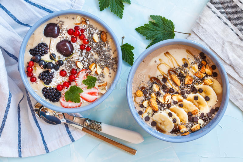 Chocolate and berry smoothies bowls. Healthy vegan breakfast: chocolate and berry smoothies bowls royalty free stock photography