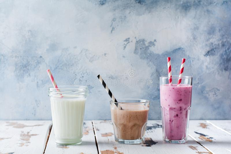 Chocolate, berry and vanilla smoothie drink. Concept of weight loss, fitness, healthy lifestyle. Healthy organic diet shakes royalty free stock photos