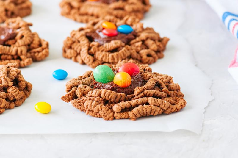 Chocolate bird`s nest cookies with ganache and decorated with co royalty free stock photo