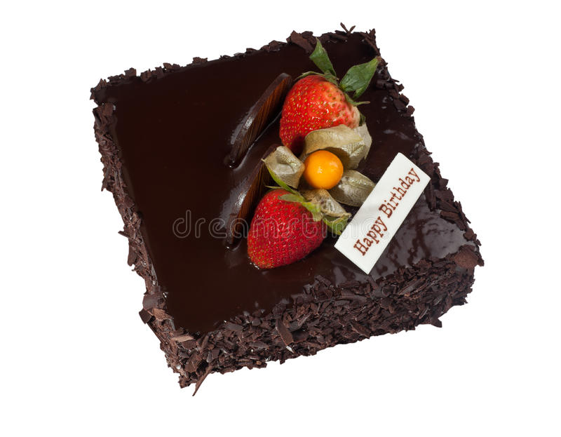 Chocolate birthday cake. With strawberry topping isolated on white background royalty free stock photography