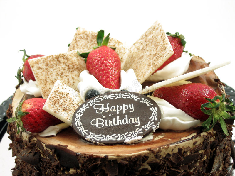 Chocolate Birthday cake. Toppings of a chocolate birthday cake in isolated white stock photography