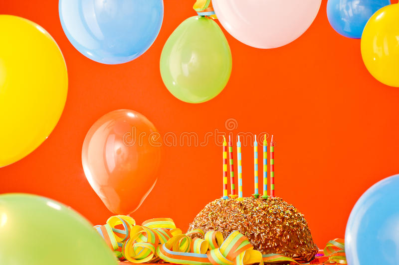 Chocolate birthday cake. With candles and ballons royalty free stock images