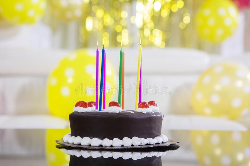 Chocolate birthday cake with colorful candles royalty free stock image