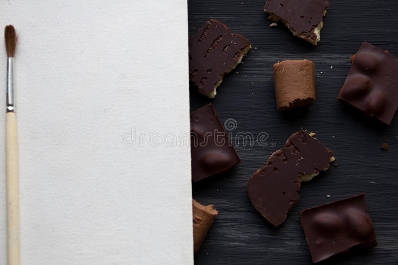 Chocolate on black the old table stock photo