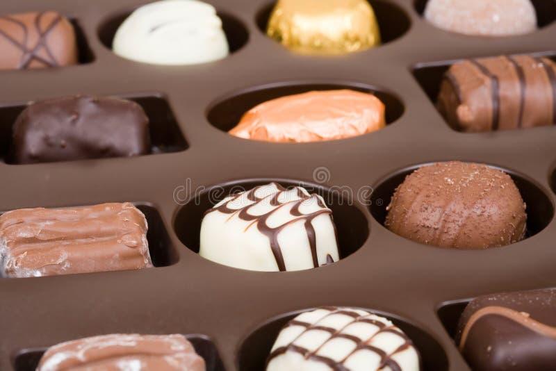 Chocolate box. Chocolate tray with assorted Belgian chocolates stock image